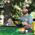 ground staff member and his son at take your daughters and sons to work day uc davis